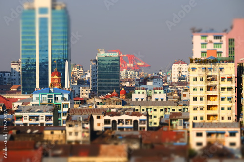 Staande foto Havana Tilt shift blur effect. Futuristic aerial view panorama of developing Yangon city. Myanmar (Burma)