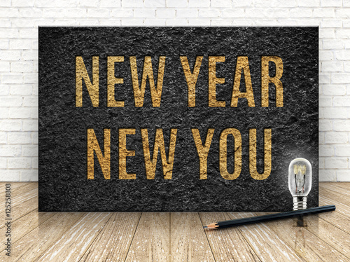 Fotografie, Obraz  Inspiration quote,New year new you word with lightbulb and penci