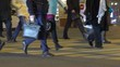 Night City. People crossing street. Crowded crosswalk. City life, Slow Motion.