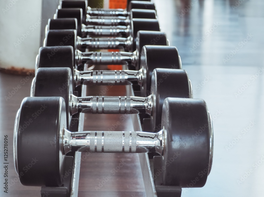 Fotografie obraz dumbbell in at the gym room color filter and