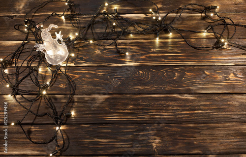 Fototapety, obrazy: Christmas lights with transparent snowman on wooden background. Rustic design