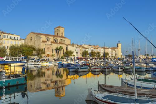Foto op Aluminium Oceanië Yachts reflecting in blue water in the old town port of La Ciota