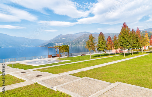 Valokuva  Autumn park with colorful trees on the lakefront of Luino, Varese, Italy