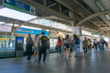 Blurred background.People standing in lines waiting for BTS sky train
