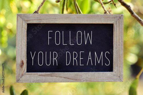Photo  chalkboard with the text follow your dreams