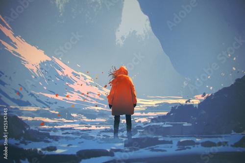 tylni widok kobieta z pomarańcze kurtki ciepłą pozycją w zima krajobrazie, ilustracyjny obraz
