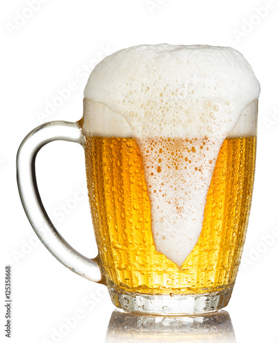 Vászonkép  cold mug of beer with foam isolated on white background