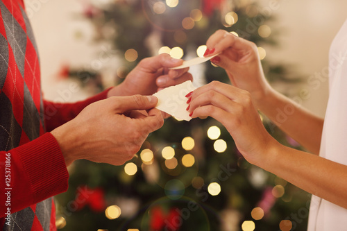 Photo  Cuple sharing Christmas wafer in Poland