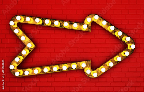 Golden arrow with light bulbs on red painted brick wall Poster