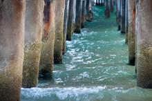 Ocean Waves Under A Boardwalk
