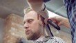 Stylish man businessman makes his Barber shop haircut.