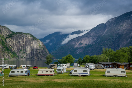 In de dag Kamperen Camping at north sea fjord with mountains background, Norway.
