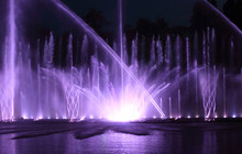 Color Water Fountain At Night Outdoor
