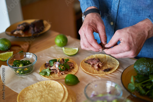 Poster Cuisine making tacos at home in kitchen