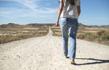 Woman With Jeans Walking