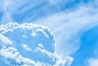 Blue sky with large cumulus clouds
