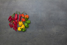 Top View On Chili Peppers Arranged In Circle On Kitchen Table With Empty Space For Text.