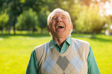 Elderly Man Laughing. Senior Male On Nature Background. Wonderful Mood Every Day. Can't Restrain The Laughter.