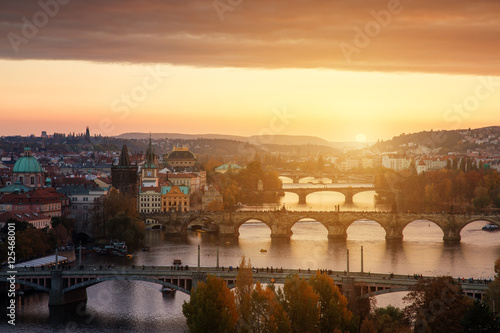 Photo Stands Lavender Sunset landscape view to Charles bridge on Vltava river in Prague Czech republic in fall.