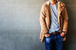 Leinwanddruck Bild - Men's casual outfits standing over gray grunge background with space, beauty and fashion concept