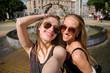 girlfriends are having fun walking in the city