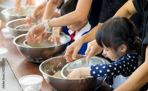 Staande foto Koken Asian children are cooking ice cream in cooking class
