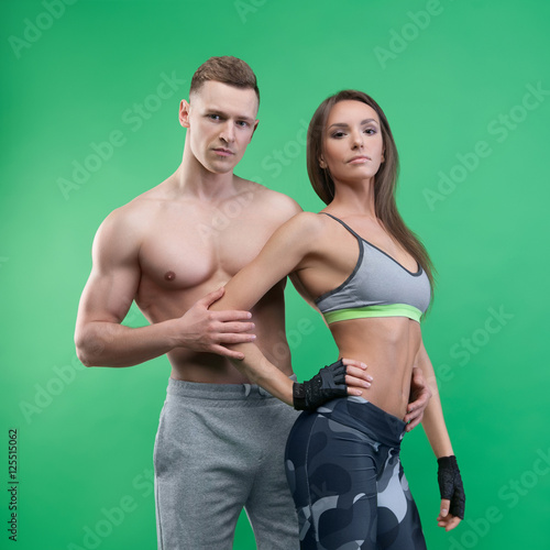 Fototapety, obrazy: Sports man and woman posing