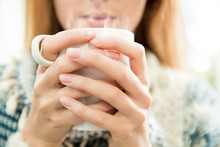 Woman Holding Cup Of Hot Coffee In Hands. Inhaling Aroma, Enjoying Morning.