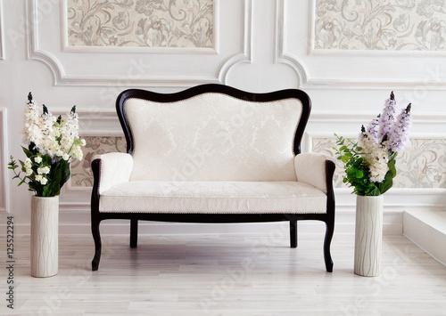 Fotografie, Obraz  beautiful interior - white sofa and flowers in vases