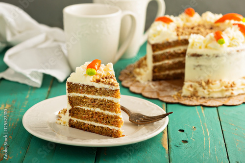 Fotografie, Obraz  Slice of carrot cake with cream cheese frosting