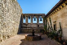 Bells Framed In Windows At Mission San Juan Capistrano