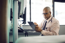Doctor Using Tablet Computer I...