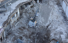 An Excavator Tear Down The Fam...