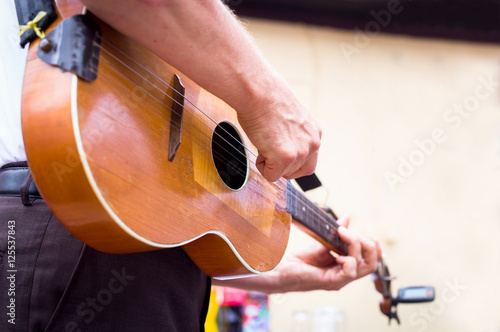 Canvastavla  Man playing guitar , close up