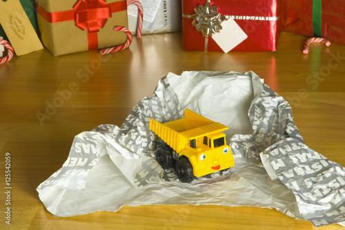 Fotografia, Obraz  Childrens Toy Christmas present unwrapped