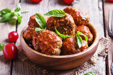 Meatballs With Tomato Sauce And Basil, Vintage Wooden Background