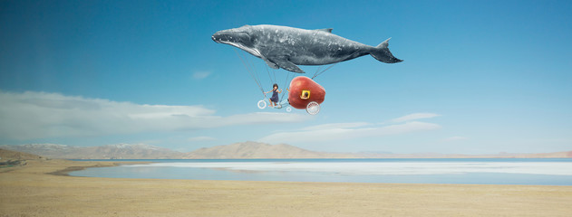 Travel concept. Whale float...