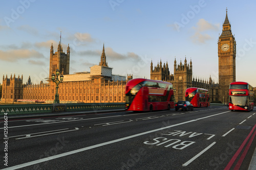 London, England, UK. Red buses blured in motion on Westminster b