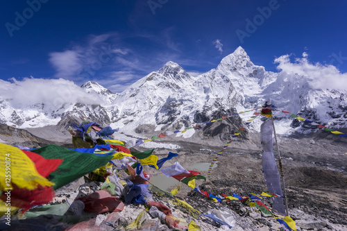 Wall Murals Nepal Beautiful Landscape of Everest and Lhotse peak with colorful Nepali flag as foreground from Kala Pattar view point. Gorak Shep. During the way to Everest base camp. Sagarmatha national park. Nepal.