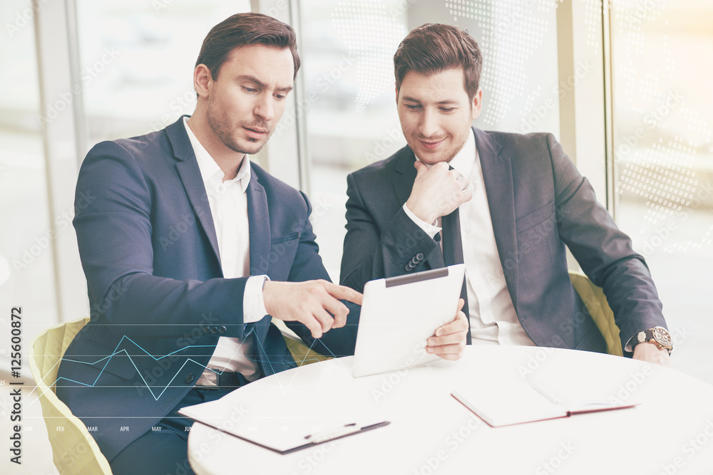 Fototapeta Young businessmen making project in an office.
