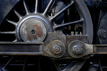 Steam Locomotive Wheels And Rods Closeup. Detail Of Mechanical Parts, Wheels And Equipment Of The Train.