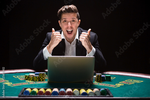Photo  Online poker players sitting at the table
