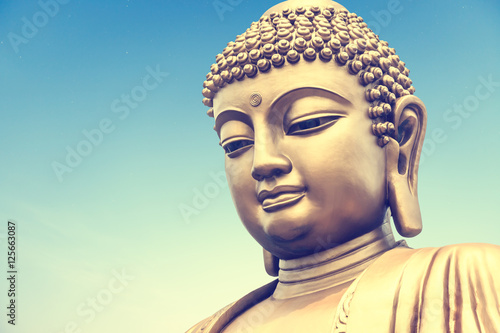 Buddha statue on the blue sky