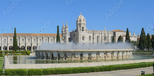 Poster Artistique Lisbon, Portugal, Belem. Fountain named Luminosa and Gardens in front of Monastery named Jeronimos