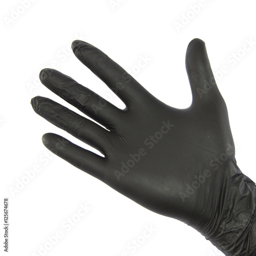 Black nitrile glove on hand. Wall mural