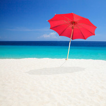 Red Beach Umbrellas With Sky Background.