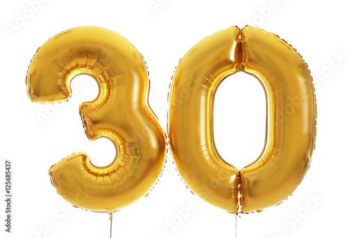 Fotografia  Golden birthday balloons on light background