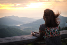 Young Woman Looking The View Of Mountain In Morning