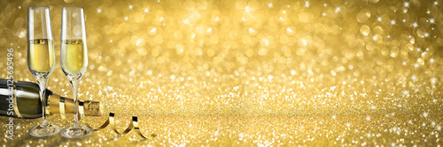 New Year Toast champagne banner, golden background