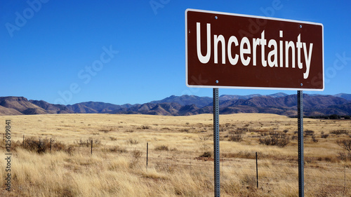 Uncertainty brown road sign Canvas Print